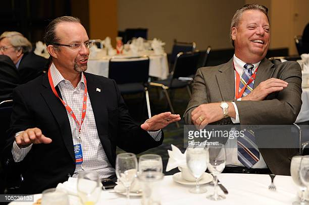 Former NASCAR driver and television personality Kyle Petty and Atlanta Motor Speedway President Ed Clark swap stories during NASCAR Hall of Fame...