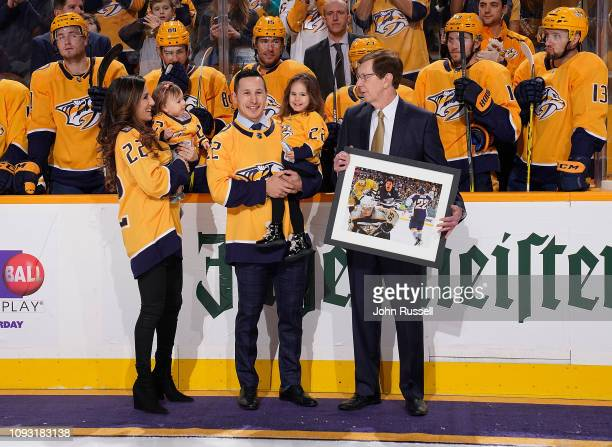 Former Nashville Predators Jordin Tootoo is honored along with his wife Jennifer and daughters Siena and Avery prior to and NHL game against the...