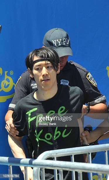 Former Nathans Famous Hot Dog Eating Champion Takeru Kobayashi arrested at the 2010 Nathan's Famous Fourth of July International Hot Dog Eating...