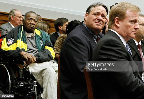 Former National Football League player Brent Boyd rubs his head while sitting next to NFL Commissioner Roger Goodell and Pro Football Hall of Fame...