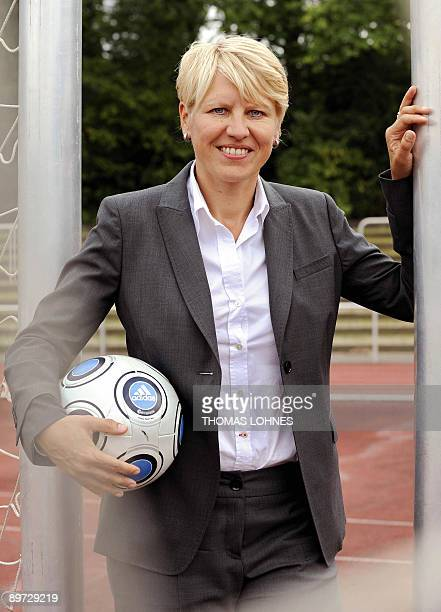 Former national football team player and new team manager of Germany's women nation football team Doris Fitschen poses during a photo session in Neu...