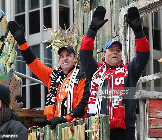 Former National Hockey League players John LeClair and Pat LaFontaine wave at the crowd as they ride the Discover NHL Thanksgiving Showdown Float...