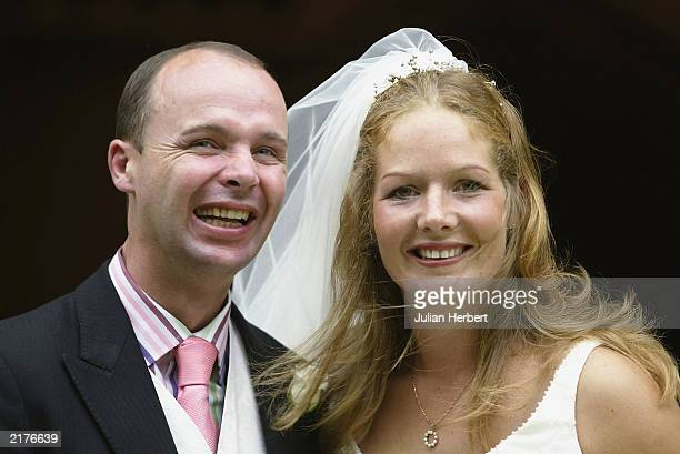 Former national hunt jockey Luke Harvey and new wife Georgie pose for a photograph after their wedding at Lambourn Village Church July 19 2003 in...