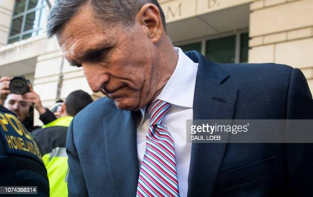 Former National Security Advisor General Michael Flynn leaves after the delay in his sentencing hearing at US District Court in Washington DC...