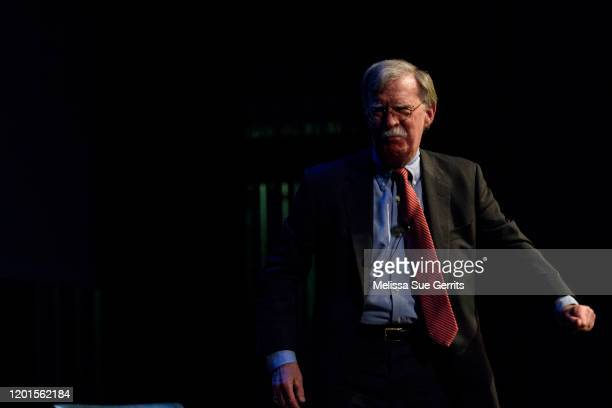 Former National Security Advisor John Bolton leaves the stage after discussing the current threats to national security during a forum moderated by...