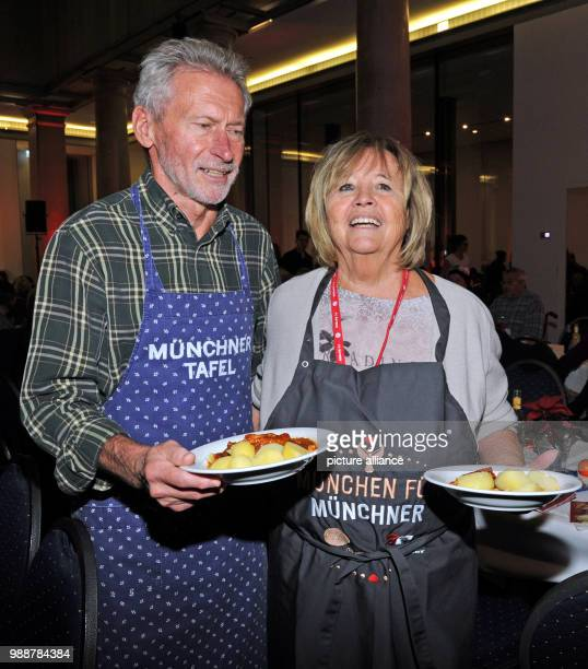 Former national soccer player Paul Breitner and his wife Hildegard supporting the Munchner Tafel eV during the distribution of food in the Old...