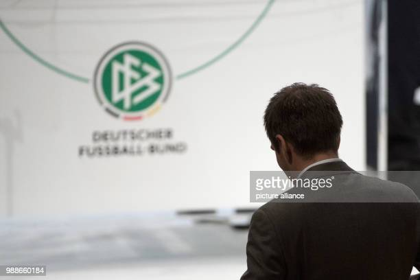 Former national soccer player Philipp Lahm walks to the stage at the extraordinary federal conference of the German Football Association  in...