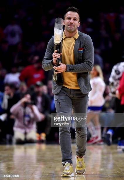 Former National Team soccer player Alessandro Del Piero of Italy participates participates in a giveaway during a timeout in the game between the...
