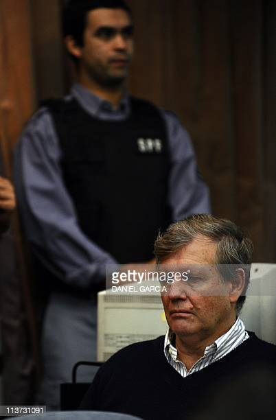Former Navy captain Alfredo Astiz attends escorted by police on May 5 to the audience of the Argentine Federal Court number five which began...