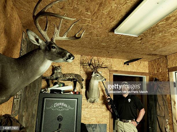 Former Navy SEAL and expert sniper Chris Kyle is photographed in a shed on his ranch for Paris Match magazine on April 2 2012 in Dallas Texas