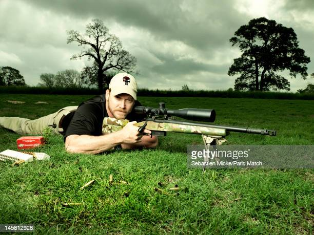 Former Navy SEAL and expert sniper Chris Kyle is photographed on his ranch for Paris Match magazine on April 2 2012 in Dallas Texas Published image