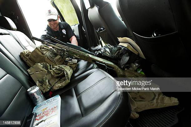 Former Navy SEAL and expert sniper Chris Kyle is photographed on his ranch for Paris Match magazine on April 2 2012 in Dallas Texas In this picture...