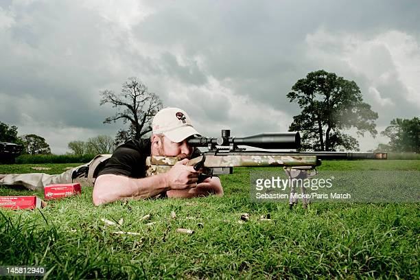 Former Navy SEAL and expert sniper Chris Kyle is photographed on his ranch for Paris Match magazine on April 2 2012 in Dallas Texas