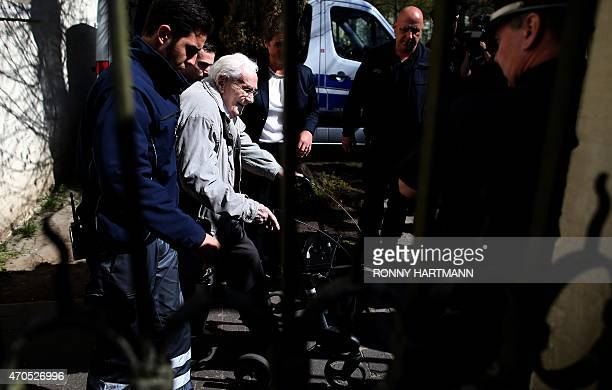 Former Nazi death camp officer Oskar Groening leaves the court after the first day of his trial on April 21, 2015 in Lueneburg, northern Germany. The...
