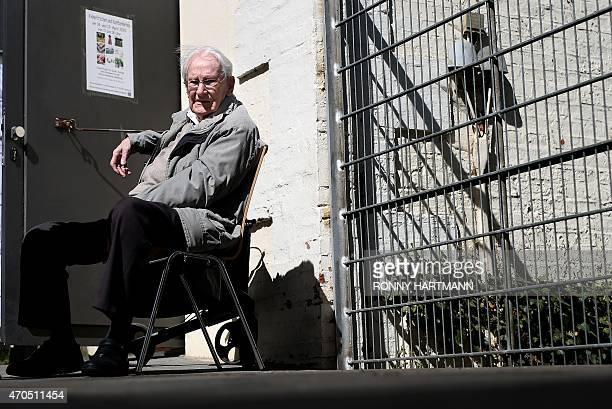 Former Nazi death camp officer Oskar Groening sits outside during a break of his trial on April 21 2015 in Lueneburg northern Germany The 93yearold...