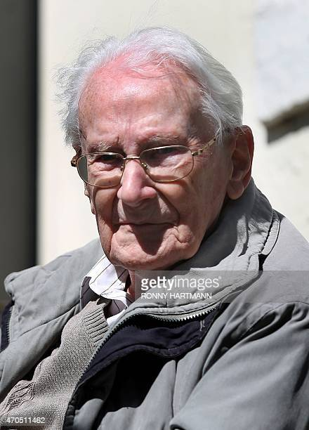 Former Nazi death camp officer Oskar Groening sits outside during a break of his trial on April 21, 2015 in Lueneburg, northern Germany. The...