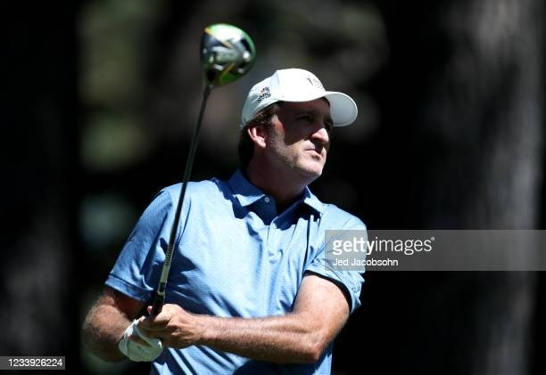 Former NBA athlete Vinny Del Negro tees off from the fourth hole during the final round of the American Century Championship at Edgewood Tahoe South...