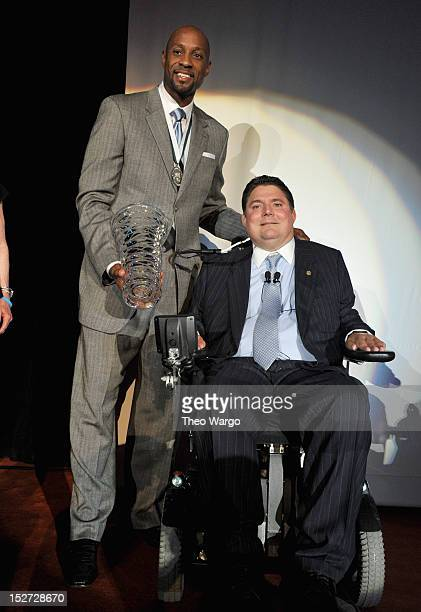 Former NBA basketball player Alonzo Mourning and former NFL football player Marc Buoniconti pose onstage at the 27th Annual Great Sports Legends...