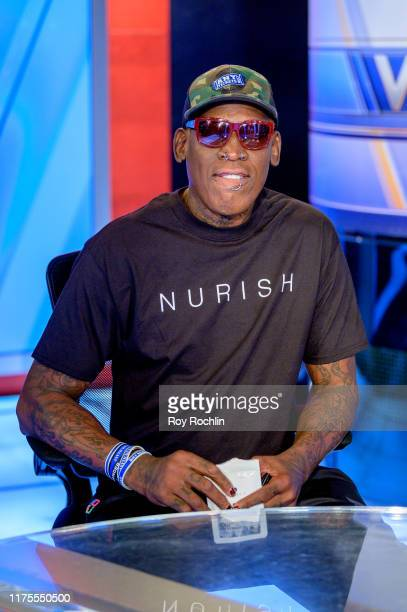Former NBA Basketball player Dennis Rodman visits Varney Co with guesthost David Asman at Fox Business Network Studios on September 18 2019 in New...