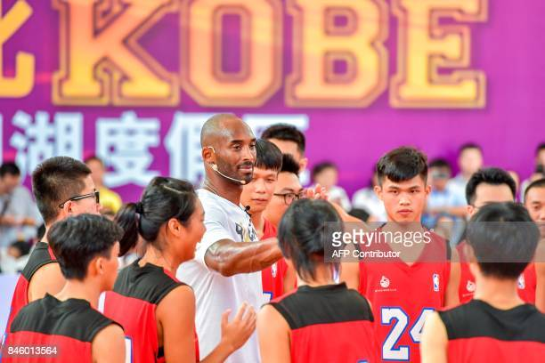 Former NBA basketball player Kobe Bryant attends a basketball teaching activity in Haikou in China's southern Hainan province on September 12, 2017....