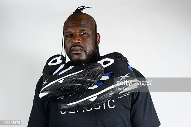 Former NBA basketball player Shaquille O'Neal poses with Reebok sneakers at the Reebok Classic Breakout at Philadelphia University on July 9 2014 in...