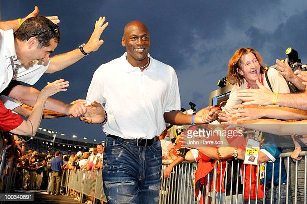 Former NBA Chicago Bulls gaurd Michael Jordon highfives the crowd during prerace ceremonies prior to the start of the NASCAR Sprint AllStar Race at...