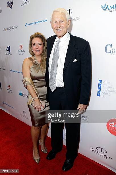 Former NBA coach Lute Olson and Kelly Pugnea attend the 16th Annual Harold Carole Pump Foundation Gala at The Beverly Hilton Hotel on August 12 2016...