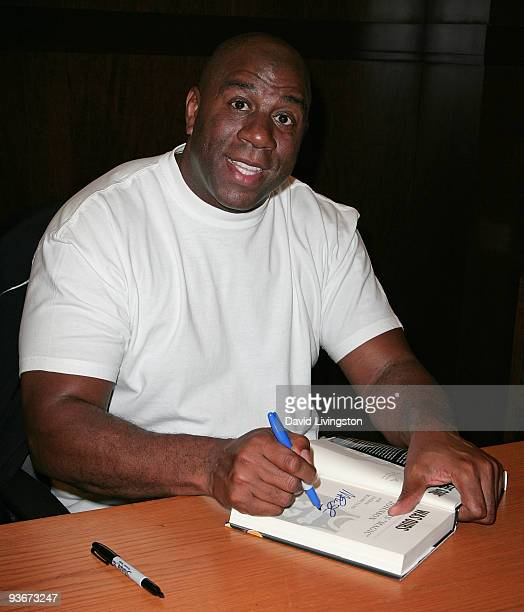 Former NBA great Earvin Magic Johnson attends a signing for his book When The Game Was Ours at Barnes Noble Booksellers at The Grove on December 2...