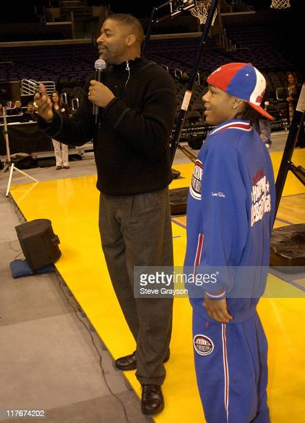 Former NBA great Norm Nixon Bow Wow during Bow Wow Gives Los Angeles School Kids A Chance To Be Like Mike at Staples Center in Los Angeles California...