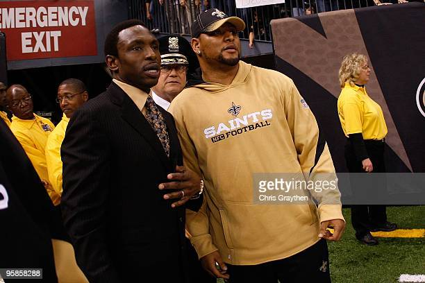 Former NBA head coach Avery Johnson and Deuce McAllister of the New Orleans Saints stand on the field against the Arizona Cardinals during the NFC...