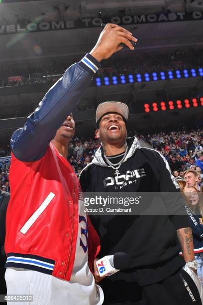 Former NBA player Allen Iverson takes a 'selfie' with a fan during the Detroit Pistons game against the Philadelphia 76ers December 2 2017 at Wells...