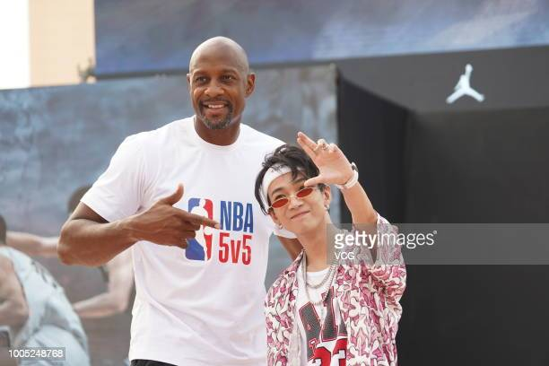 Former NBA player Alonzo Mourning and Chinese rapper Tizzy T attend activity on July 21 2018 in Guangzhou Guangdong Province of China