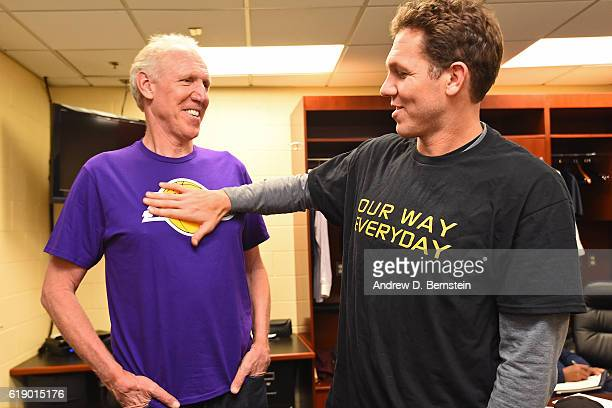 Former NBA player Bill Walton and Luke Walton of the Los Angeles Lakers talk before the game against the Houston Rockets on October 26 2016 at...