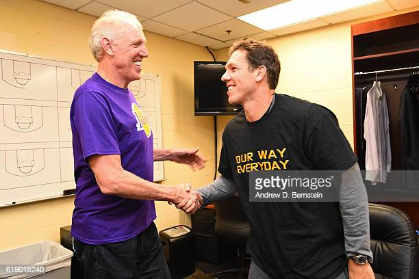 Former NBA player Bill Walton and Luke Walton of the Los Angeles Lakers shake hands before the game against the Houston Rockets on October 26 2016 at...