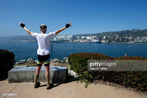 Former NBA player Bill Walton looks out to San Diego Bay during the Inter-Galactic Bike for Humanity fund raiser to benefit victims of the COVID-19...