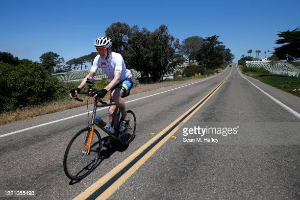 Former NBA player Bill Walton rides his bike past Fort Rosecrans National Cemetery during the Inter-Galactic Bike for Humanity fund raiser to benefit...