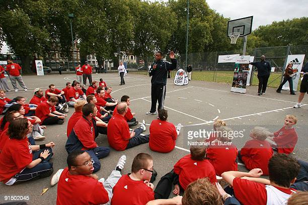 Former NBA player BJ Armstrong speaks to children at a Special Olympic Clinic during the 2009 NBA Europe Live on October 3 2009 at Turnpike Lane in...