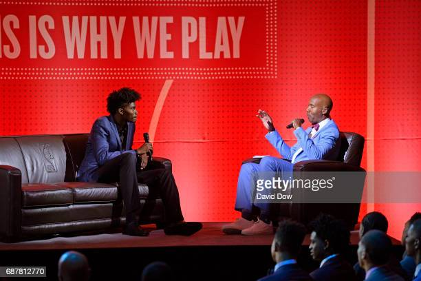 Former NBA player Bruce Bowen has a conversation with NB ADraft prospect Jonathan Isaac during the 2017 NBA Draft Lottery at the New York Hilton in...