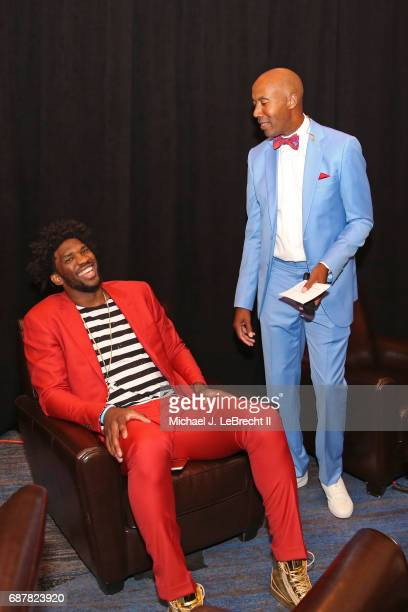 Former NBA player Bruce Bowen talks with Joel Embiid of the Philadelphia 76ers during the 2017 NBA Draft Lottery at the New York Hilton in New York...