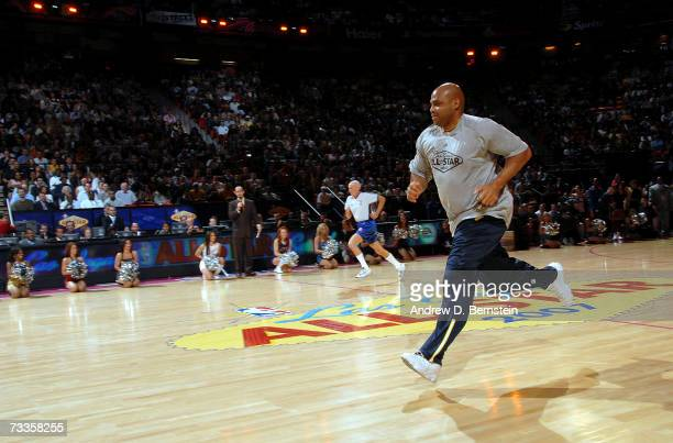 Former NBA player Charles Barkley and NBA referee Dick Bavetta race at NBA AllStar Weekend at the Thomas Mack Center February 17 2007 in Las Vegas...