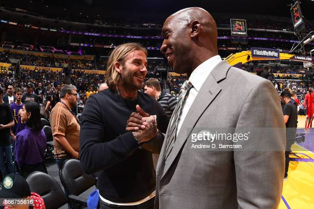 Former NBA player Chauncey Billups greets soccer player David Beckham after the Washington Wizards game against Los Angeles Lakers on October 25 2017...