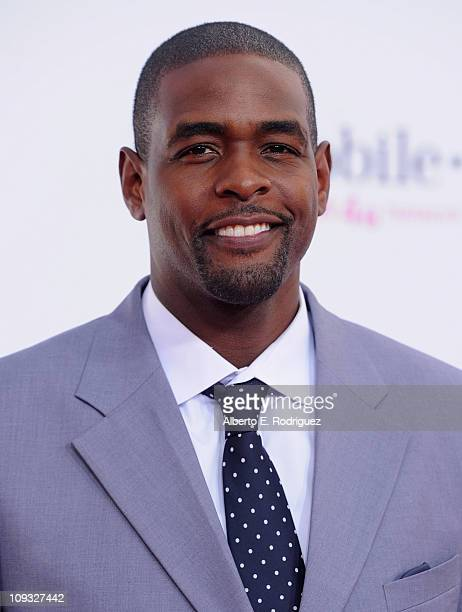 Former NBA player Chris Webber arrives to the TMobile Magenta Carpet at the 2011 NBA AllStar Game on February 20 2011 in Los Angeles California