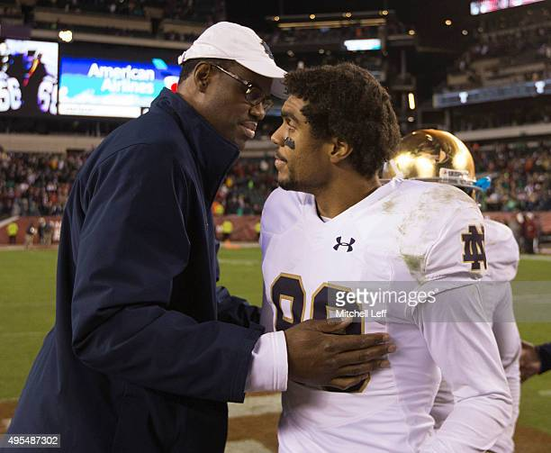 Former NBA player David Robinson hugs his son Corey Robinson of the Notre Dame Fighting Irish after the game against the Temple Owls on October 31...