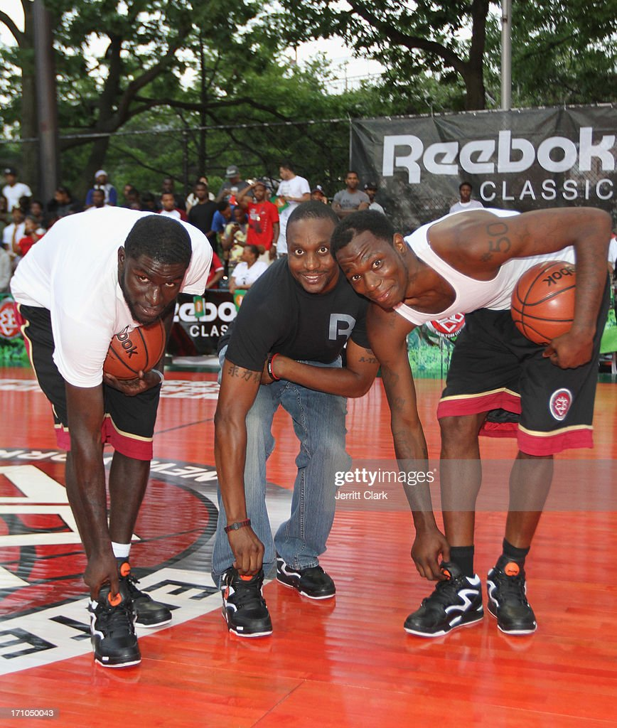 Former NBA Player Dee Brown poses with Dunk contestants Africa and Kiwan Smith at the Reebok Classic Pump Omni Lite Dunk Contest at EBC at Rucker Park on June 20, 2013 in New York City.