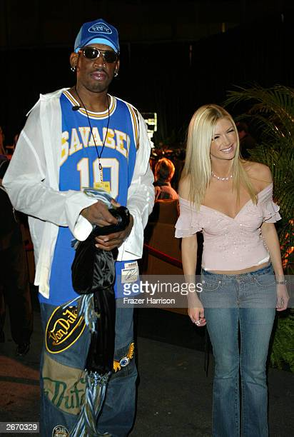 Former NBA player Dennis Rodman and actress Brande Roderick arrive at the 2003 Tall Pony Radio Music Awards gift lounge outside the Aladdin Hotel and...