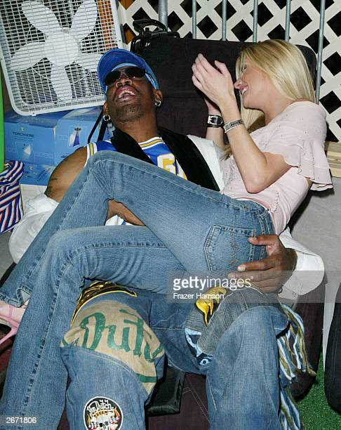 Former NBA player Dennis Rodman and actress Brande Roderick sit on the Sharper Image massage chairs at the 2003 Tall Pony Radio Music Awards gift...