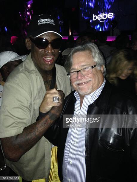 Former NBA player Dennis Rodman and Miami Heat owner Micky Arison pose circa March 2014 in Miami Florida