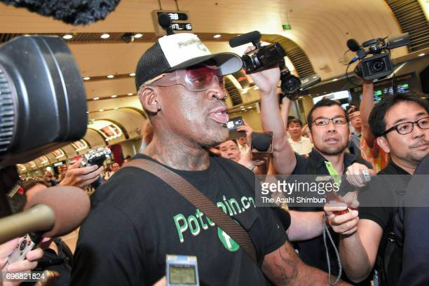 Former NBA player Dennis Rodman is surrounded by media reporters on arrival at Beijing International Airport after visiting North Korea on June 17...