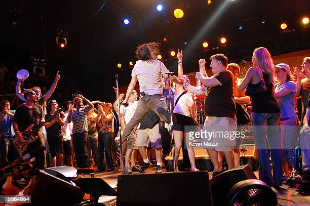 CHICAGO AUGUST 05 Former NBA player Dennis Rodman Singer/Guitarist Eddie Vedder of Pearl Jam and Tomas Young Iraq war vetran whose story is told in...