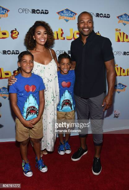 Former NBA player Derek Fisher television personality Gloria Govan and her sons Isaiah Barnes and Carter Barnes arrive at the premiere of Open Road...